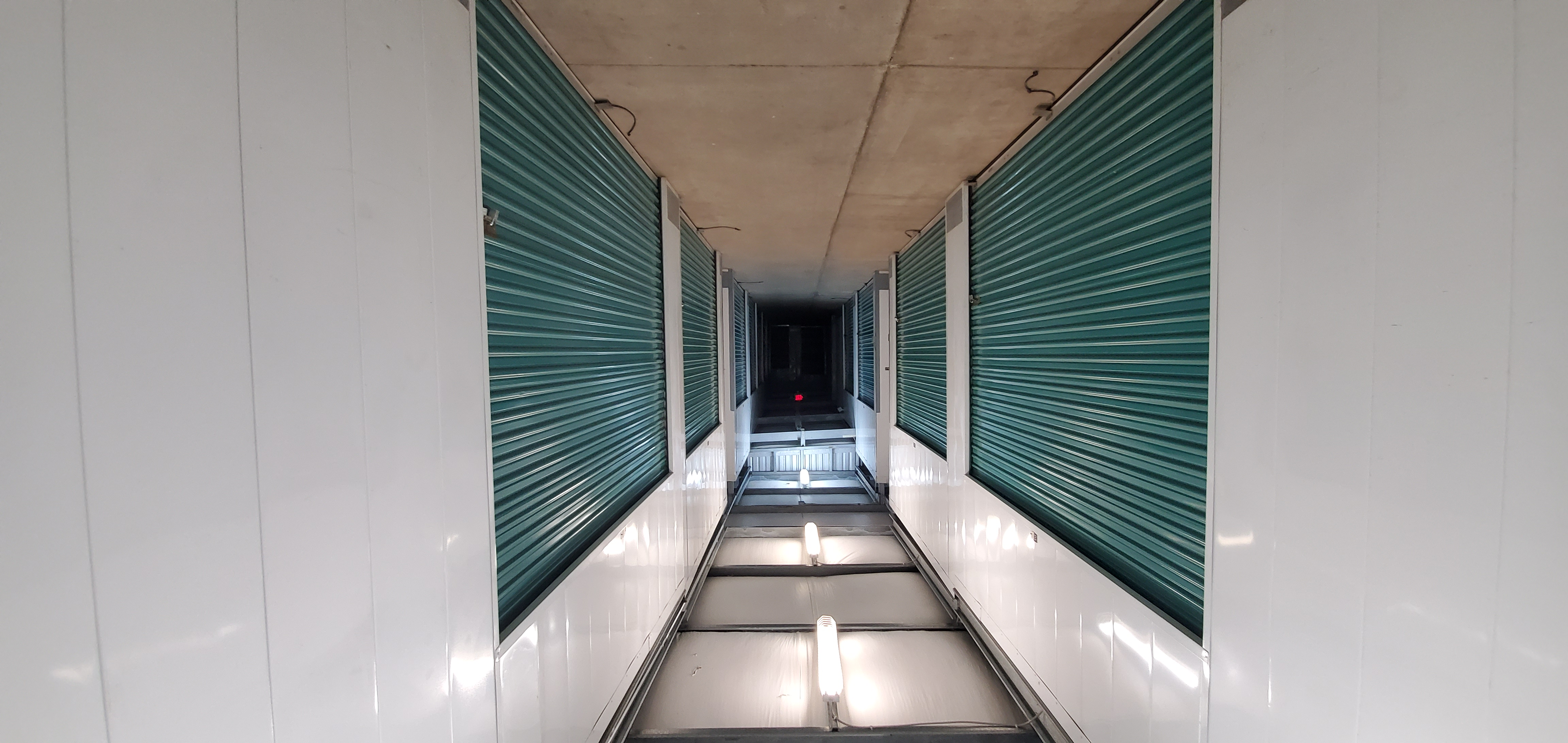 Hallway with interior storage units on both sides