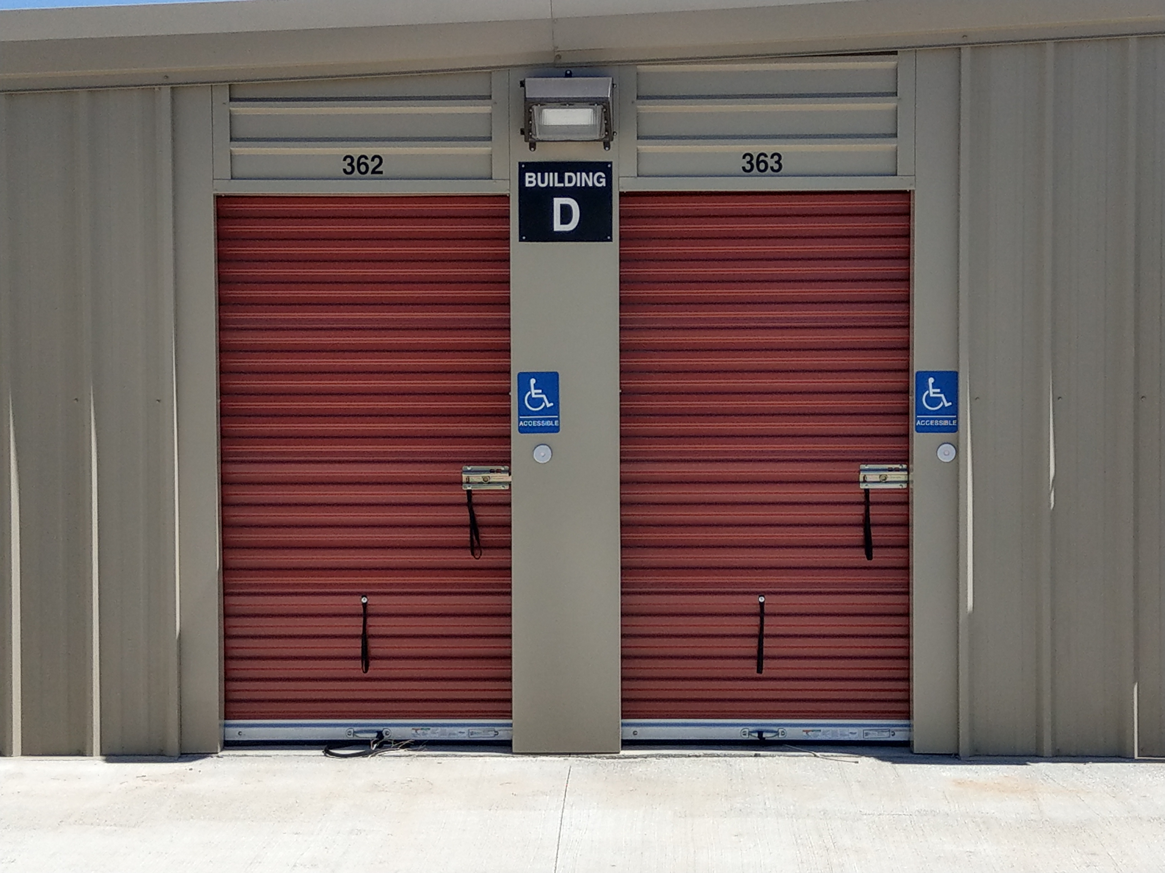 two storage units with wheelchair accessible entrances