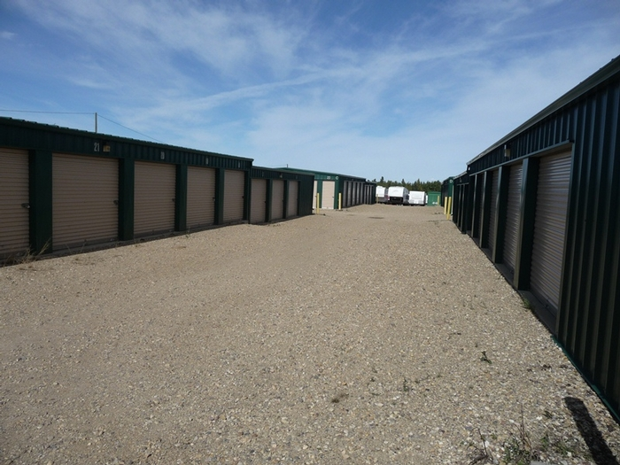 storage buildings with driving aisle in between