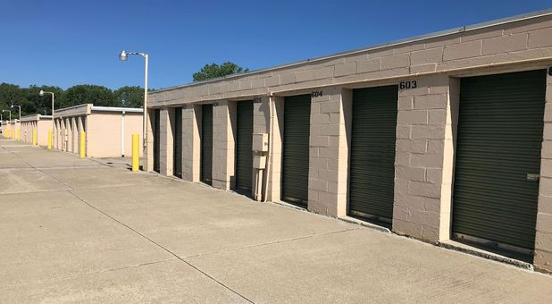 Outdoor, drive up storage units with green doors