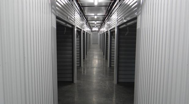 Hall of indoor self storage units at Arrowhead Self Storage of Glenpool