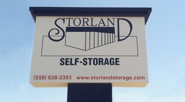 Storland Self Storage Reedley roadside sign