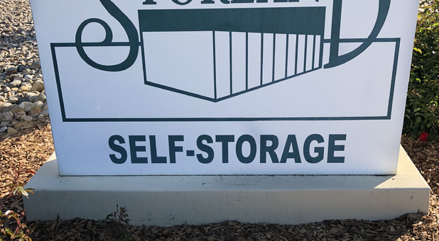 Storland Self Storage roadside sign in Tulare, CA