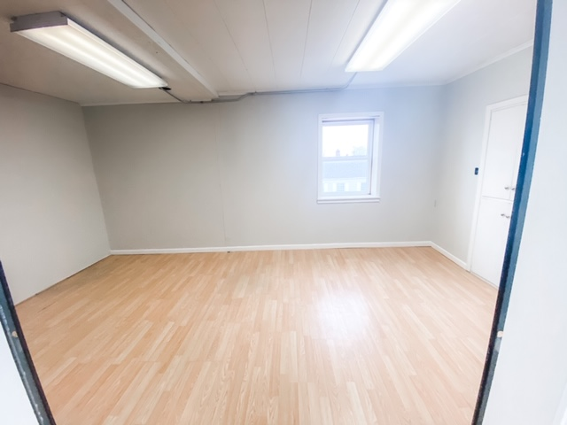empty room with wooden floors and finished walls