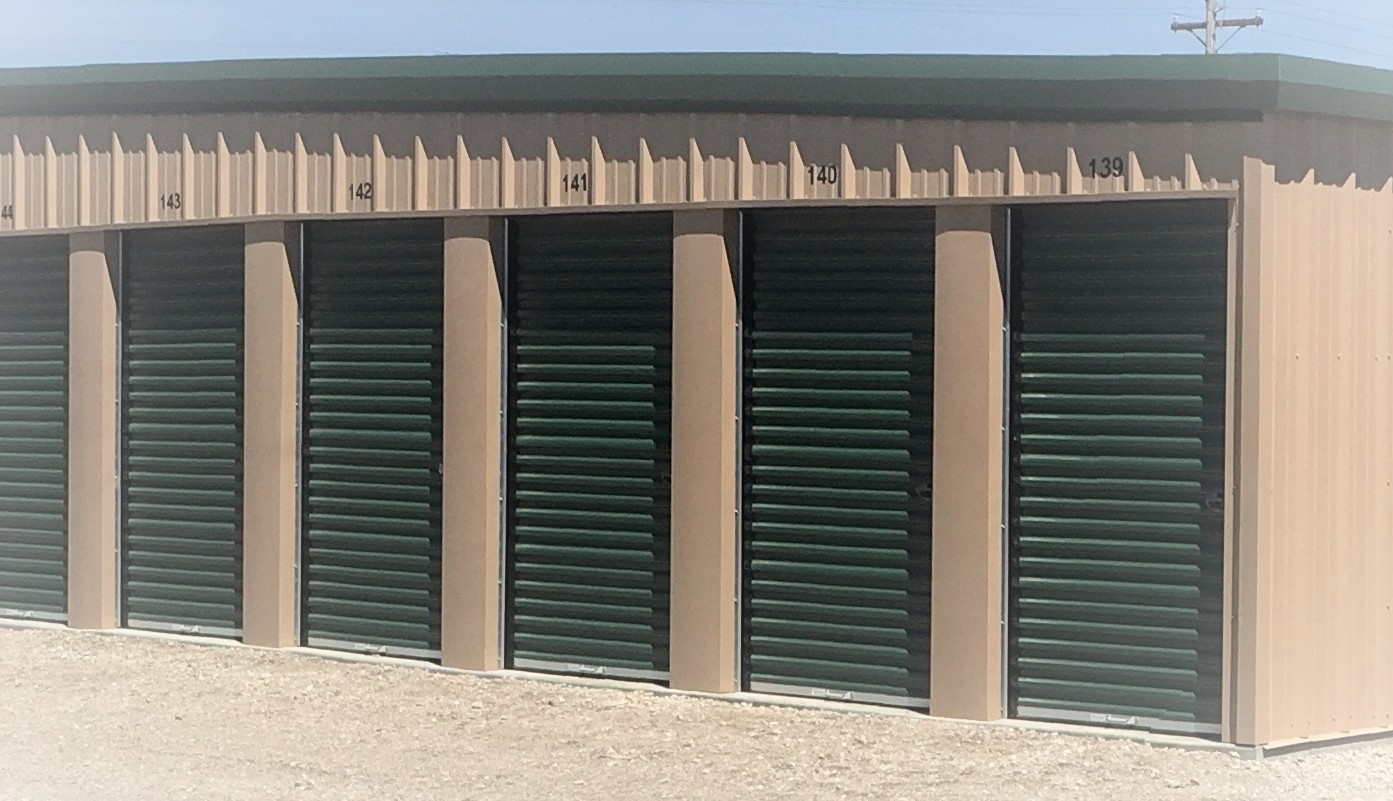photo of a row of storage units with 4.5x7 roll-up doors