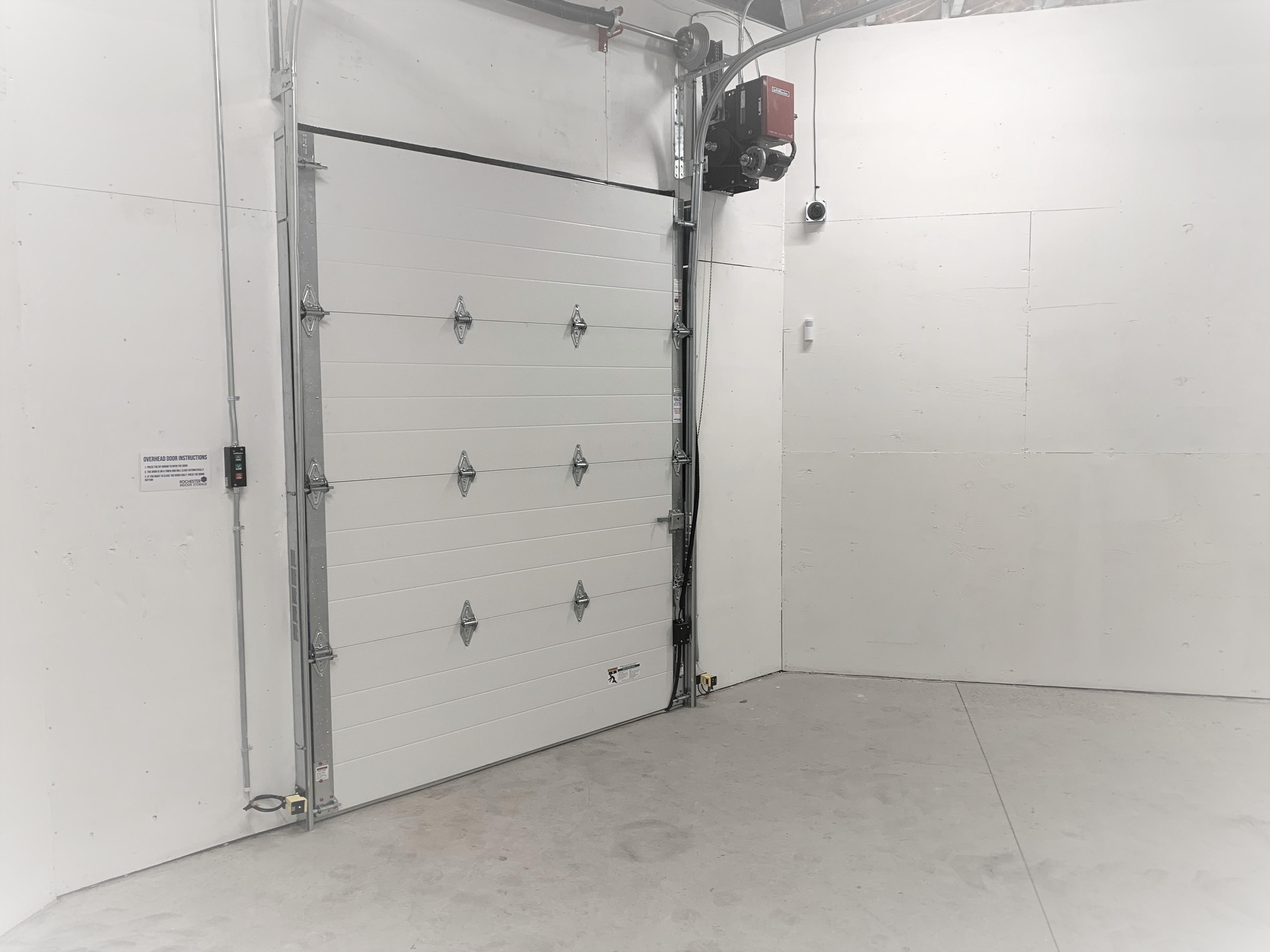 interior of storage unit with roll up door