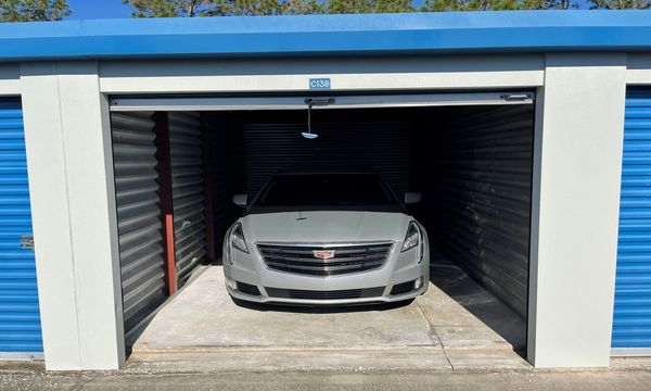 Inside view of our exterior 10x20 storage unit with car parked inside