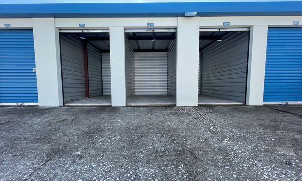 Inside view of our exterior 5x10 storage units with blue rollup doors