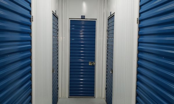 Interior hallway with climate controlled storage units at Fort Knox Self Storage Lady Lake
