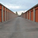 two rows of exterior storage units with large doors