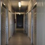 hallway with storage unit doors